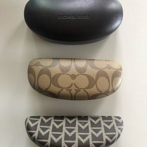 Micheal Kors and Fendi sunglass cases